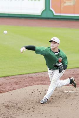 Rachel Von | The Journal Gazette TinCaps' T.J. Weir pitches the ball during the TinCaps first practice at Parkview Field in downtown Fort Wayne, IN on Monday. The TinCaps first home game is at 4:05 p.m. on Sunday April 12th. GALLERY