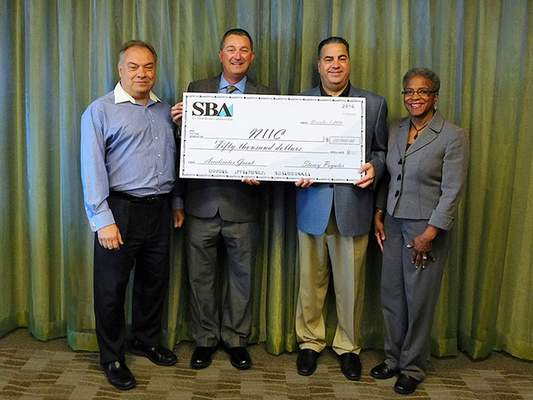 Courtesy photo U.S. Small Business Administration (SBA) presents SBA Growth Accelerator Fund to The NIIC, shown left to right: Michael Fritsch, Director of Revenue Development, The NIIC; Stacey Poynter, District Director, U.S. SBA; Karl R. LaPan, President and CEO, The NIIC; Sandra Wharton, Director, Women's Economic Opportunity Center.
