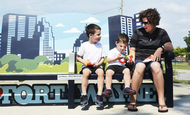 FILE: A family takes a snack break next to the Historic Wells Street Bridge along the downtown riverfront.