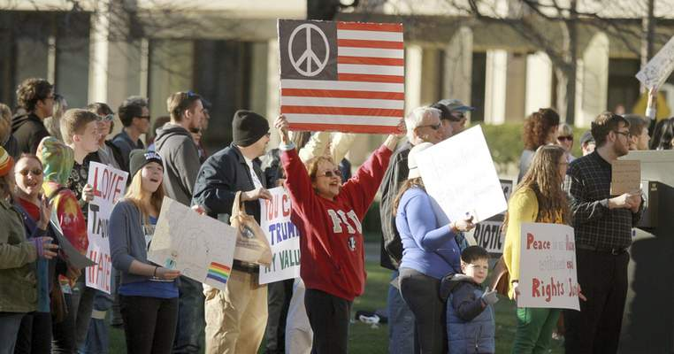 """Rachel Von   The Journal Gazette About 150 to 200 people gathered at the Allen County Courthouse along Clinton Street on Sunday for the """"Fight Hate With Love"""" rally. """"We can't stay in a state of hate and blame,"""" attendee Rhonda Woody said."""