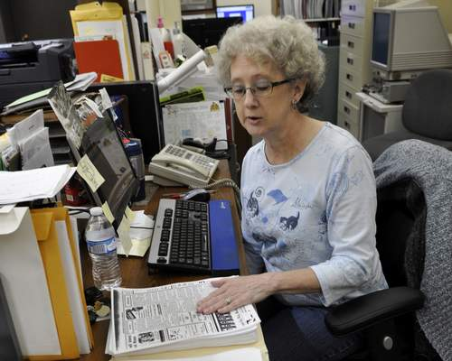 Associated Press Bonita Johnson, local history and genealogy coordinator at the Princeton Public Library, retypes obituaries to an online database maintained by an Evansville funeral home in Princeton, Ind.