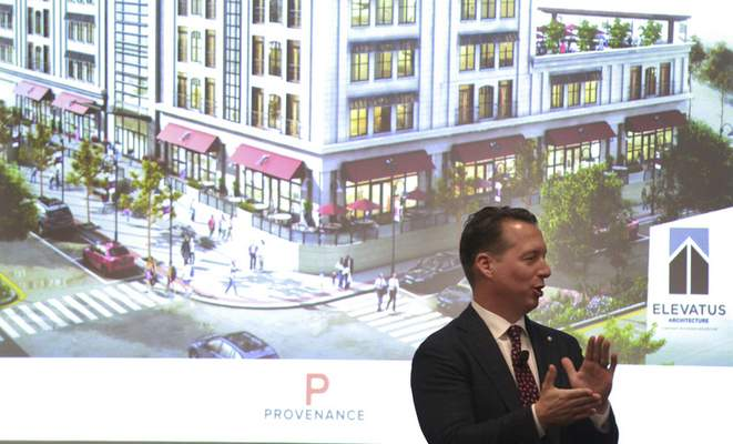 Photos by Rachel Von   The Journal Gazette Eric Doden, CEO of Greater Fort Wayne Inc., spoke Tuesday at Ash Brokerage about Vera Bradley co-founder Barbara Bradley Baekgaard partnering with Provenance Hotels to develop a boutique hotel in Fort Wayne.