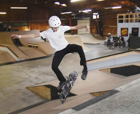Samuel Hoffman | The Journal Gazette Logan Atkinson, 13, grabs air as he competes in the intermediate event at the Fort Wayne Indoor Skatepark on Saturday. Skateboarders and BMX riders have come from around the Midwest to the facility.
