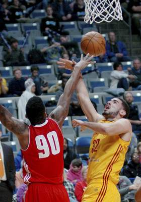 Samuel Hoffman | The Journal Gazette Mad Ants forward Georges Niang is defended by Maine's Malcolm Miller. Niang scored 13 points in his Mad Ants debut after coming from the Pacers.