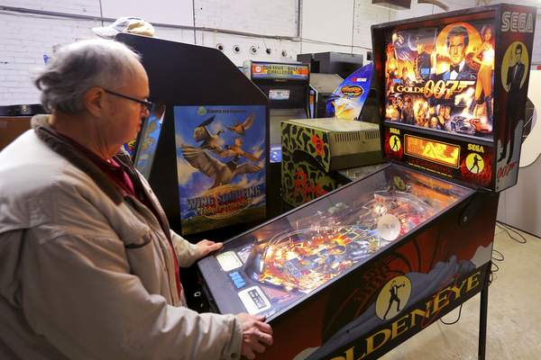 Associated Press Jeff Collins, owner of Ace Music, has unknowingly been breaking the law by selling pinball machines in Kokomo.
