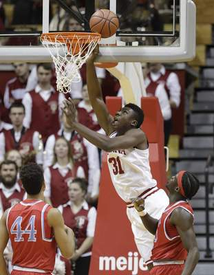 Associated Press Indiana center Thomas Bryant puts up a shot against Delaware State center Demola Onifade, right, and forward DeVaughn Mallory on Monday night at Assembly Hall. Bryant had 14 points and six rebounds against the undersized Hornets.