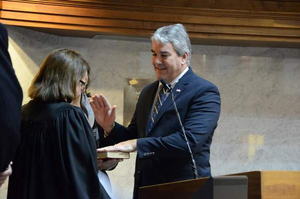 Courtesy photo Sen. Andy Zay takes the oath given by Indiana Supreme Court Justice Loretta Rush Tuesday.