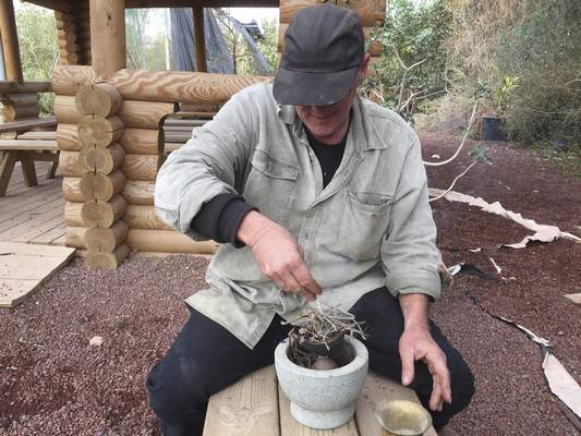 Washington Post Israeli farmer Guy Erlich uses resin, dried and crushed, from the commiphora plant to make myrrh, an ancient plant little used today.