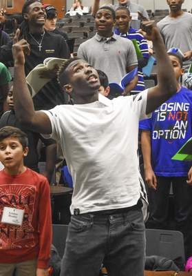 James McGlaston Williams, 18, sings a song of praise during rehearsal.