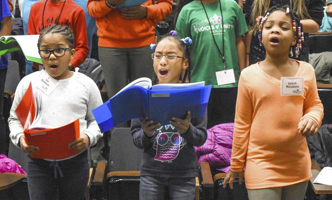 From left, choir members Jaz Dunham, 9, Vanessa Fullerton, 8, and Aniyah McLemore, 8, sing during rehearsal for Sunday's show, which will feature Christian praise ­music.
