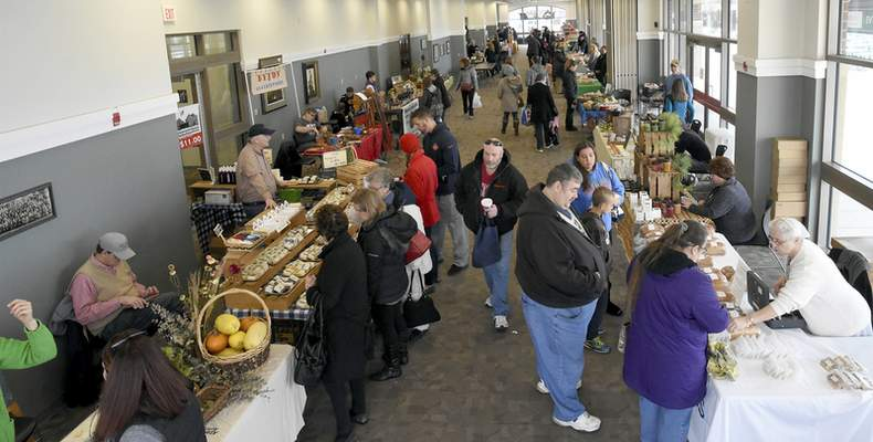 Photos by Rachel Von | The Journal Gazette Shoppers enjoy the variety of vendors and goods during the Fort Wayne's Farmers Market at Parkview Field. The indoor market is open until May 13.