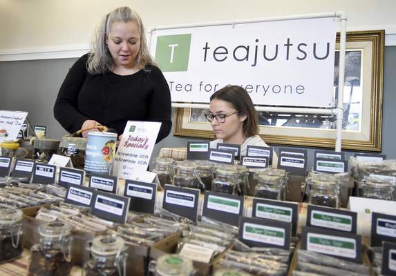 Rachel Von | The Journal Gazette Michelle Lusch, left, and daughter Cybil, 18, work at the tea stand Teajutsu during Fort Wayne's Farmers Market at Parkview Field. Teajutsu offers a variety of loose leaf teas for customers at the market on Saturdays and online.