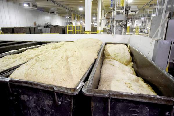 Photos by Samuel Hoffman | The Journal Gazette Troughs of raw dough, called sponges, are allowed to rise about four hours after mixing. Each sponge can produce about 900 loaves of bread.