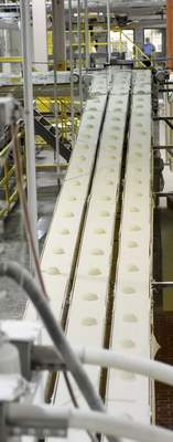 Behind The Scenes at Aunt Millies Bakery: balls of dough are on their way to be flattend, rolled and baked into loaves of bread.