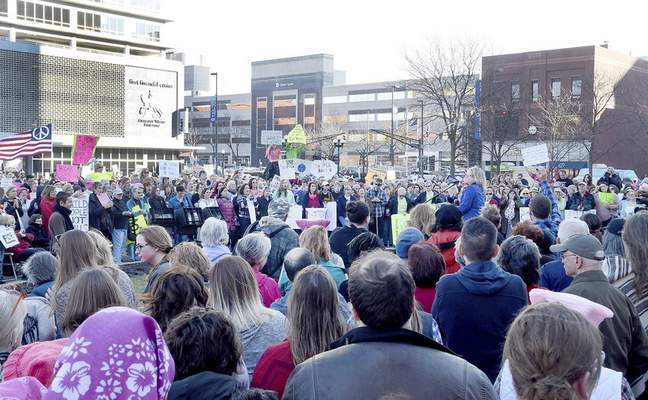 Samuel Hoffman | The Journal Gazette Several hundred protesters joined the People For The Common Good and listened to speakers Saturday at the protest rally on the Courthouse Green.