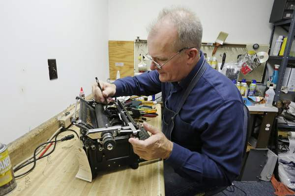 Associated Press Jim Courter gives an Underwood typewriter from the 1940s a tune up at Typewriters Plus, the Lafayette business he has owned and operated for 19 years.