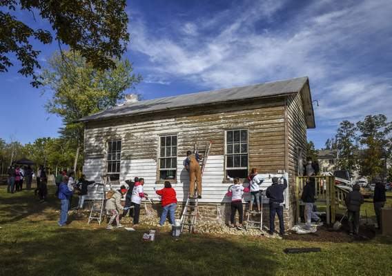 Washington Post After the Ashburn Colored School in Ashburn, Va., a 19th-century schoolhouse, was vandalized with racist symbols and hate language, a group of volunteers tackled repainting the exterior in October.