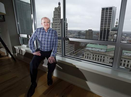 Chad Ryan | The Journal Gazette Leonard Helfrich lives in a corner condominium on the 15th floor of the Anthony Wayne Building where he has sweeping vistas overlooking Courthouse Green, Freimann Square and Headwaters Park.