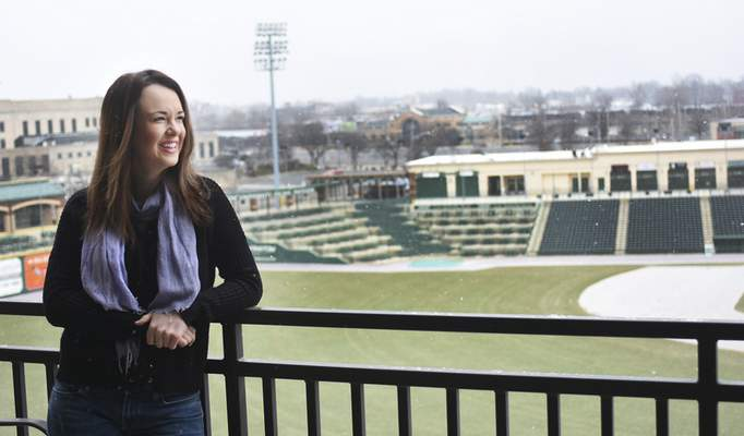 Rachel Von | The Journal Gazette Emily Baransy enjoys the view from her apartment at The Harrison that overlooks Parkview Field.