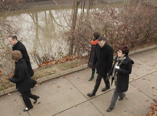 FILE  Members of the city's Riverfront Development Team walk along the Rivergreenway by Headwaters Park.