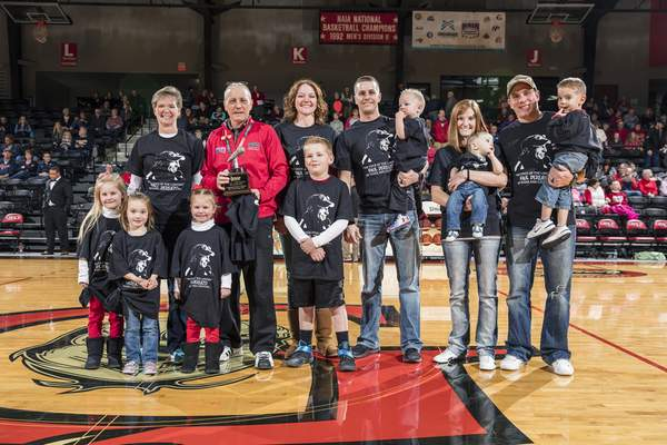 Grace University Longtime Grace College public address announcer Paul DeRenzo was honored with a ceremony Saturday, honoring his three decades of service to Grace Athletics.DeRenzo, in his 30th year, received a plaque and a surprise from his family.