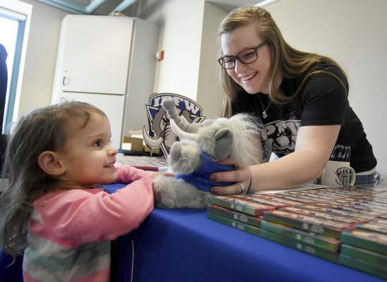 Photos by Rachel Von | The Journal Gazette Brooklyn Bertsch, 2, is all smiles as IPFW Admissions' Dindy Dressler shows her a stuffed mastodon during IPFW Sponsorship Day at Science Central on Saturday.