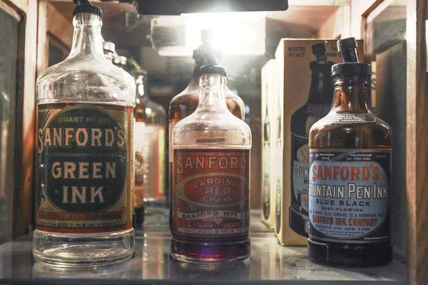 Antique ink bottles are part of Reche's collection.