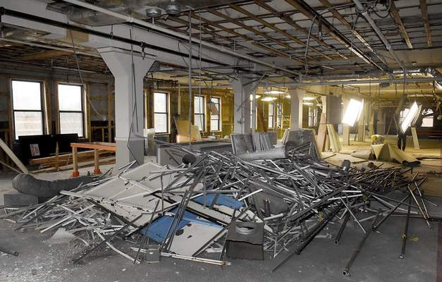 Photos by Samuel Hoffman | The Journal Gazette The old ceiling tile support system is currently piled up at Superior Lofts, which is one of a number of new loft-style apartments that will soon litter downtown Fort Wayne.