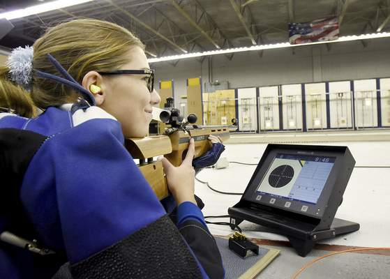 Samuel Hoffman   The Journal Gazette Samantha Shultz, 14, practices with a small-bore rifle at The X Count rifle range. Shultz, a member of the Bishop Dwenger rifle team, has been shooting for two years.