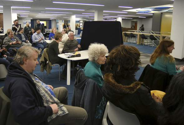 Rachel Von   The Journal Gazette Guests listen during to community leaders to outline their vision for IPFW's future Friday at the Helmke Library. The group outlined eight items it believes are vital to the local campus.