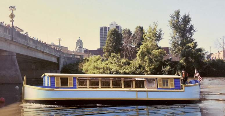 Courtesy An artist's conception shows the authentic 54-foot canal boat that is expected to begin touring city rivers June 1.