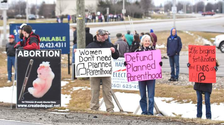FILE Protesters on both sides of the abortion issue gather at the Fort Wayne office of Planned Parenthood.