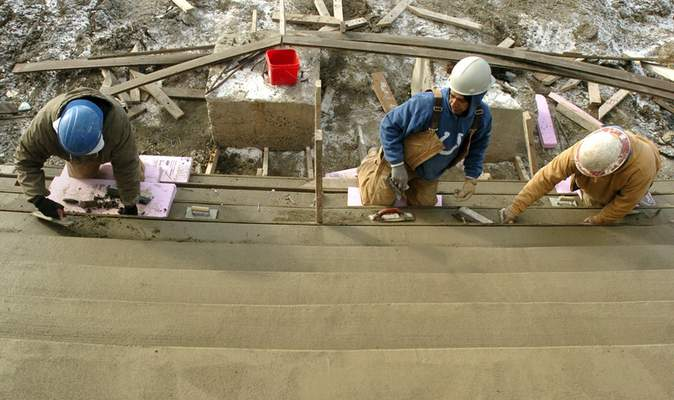 File Hagerman Construction concrete finishers work on the stairs in front of Parkview Field onDec. 31, 2008.