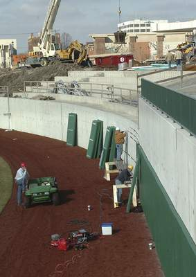 File Contractors install padding on the right field wall at Parkview Field, Feb. 13, 2009.