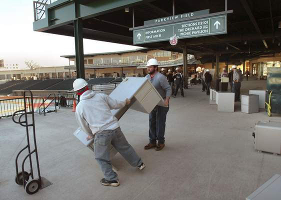 File TinCaps staffers Dan Watson, left, and Justin Shurley unload a desk on the concourse at Parkview Fieldon Feb 13, 2009. The team management was moving into their new offices downtown.