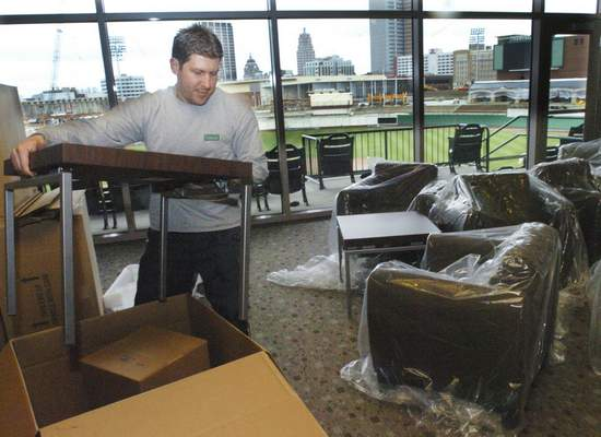 File Gary Wohlwend, owner of Ideal Office Source, unboxes furniture for the suites at Parkview Field as finishing touches are made on March 29, 2009.