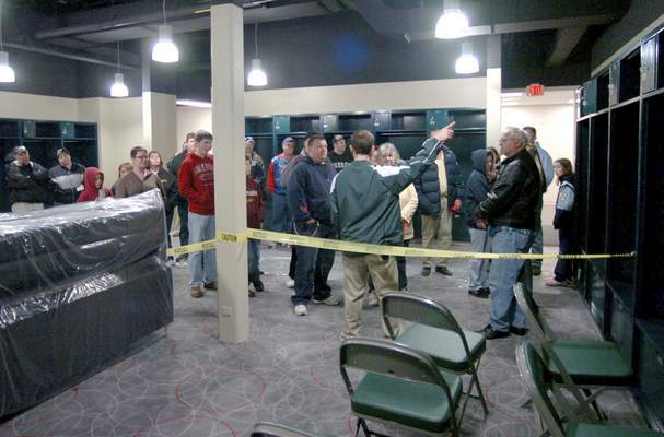 File A tour group visits the TinCaps clubhouse during a Parkview Field open house on April 4, 2009.
