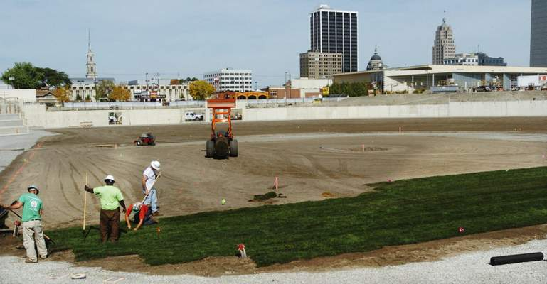 File Workers with Motz Group install sod on the field Oct. 13, 2008.