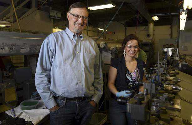 Rachel Von | The Journal Gazette Precision Die Technologies President and owner John Freiburger has gotten good results hiring immigrants such as Bosnian Irma Mrzljak. She polishes the inside of a diamond wire die at the Speedway Drive plant on Thursday.