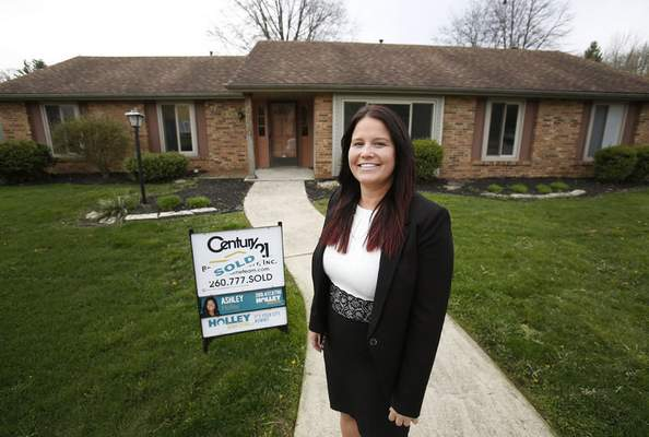 Chad Ryan | The Journal Gazette Realtor Ashley Holley represented an investor who purchased this house at 6920 White Eagle Drive and flipped it within 48 hours.