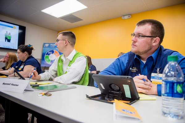 Walmart employees sit through a training academy course. A local training academy is opening next week in the Lima Road store. Courtesy photo
