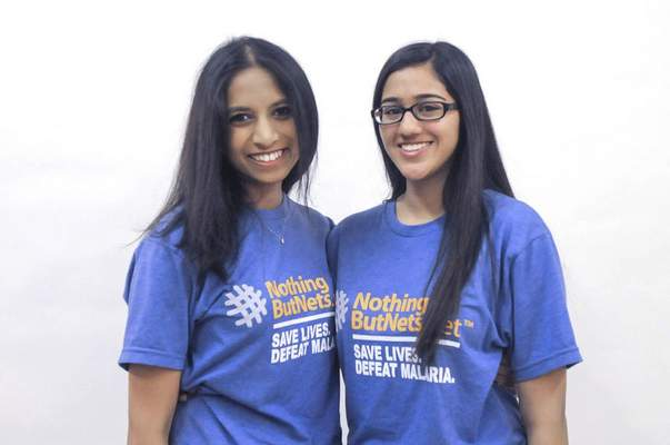 Michelle Davies   The Journal Gazette Canterbury High School students Priyanka Meesa, left, and Hiba Akbar are fighting the spread of malaria through Nothing But Nets.