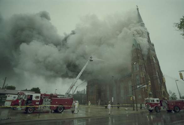 File Sept. 2, 1993: Firefighters battle the blaze at St. Mary's Catholic Church downtown.