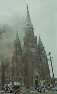 File Sept. 2, 1993: Smoke rises fromSt. Mary's Catholic Church downtown before the blaze brought down the steeple.
