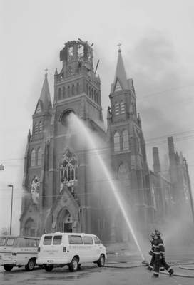 File Sept.2, 1993: Crews continue to pump water into St. Mary's Catholic Church.