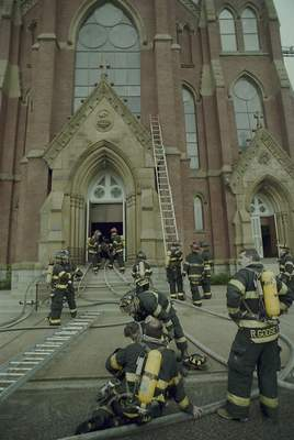 File Sept. 2, 1993: Firefighterswork at St. Mary's Catholic Church downtown.