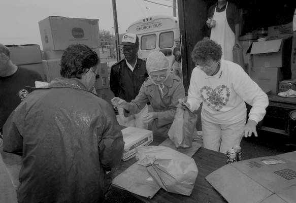 File Sept. 3, 1993: The day after the fire, about 500 people were served food out of the back of a truck in the church's parking lot. The church's soup kitchen normally fed 2,000 a day.