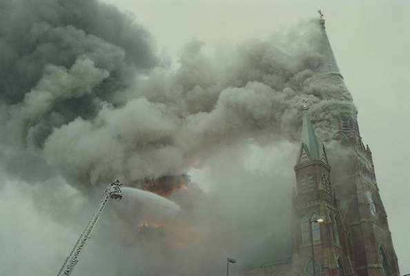 File Sept. 2, 1993: Smoke rose into the cloudy sky as St. Mary's Catholic Church burned downtown.