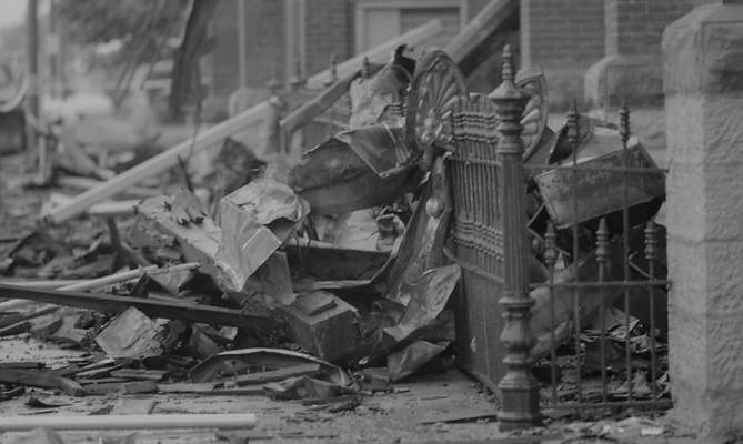 File Sept. 3, 1993: Rubble lines the sidewalks outside St. Mary's Catholic Church the day after the fire.