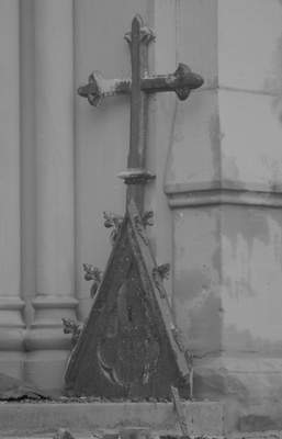 File Sept. 3, 1993: A cross is among rubble outside St. Mary's Catholic Church the day after the fire.
